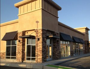 Black commercial aluminum awnings for entryways and windows