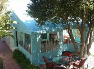 Patio shade awning with custom baby blue awning fabric and clear plastic panels