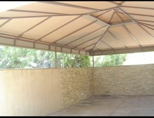 Carport awning with beige awning fabric
