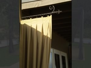 Gold drapes on a spearhead awning