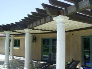 Black and white trellis cover with white slide on wire awning fabric