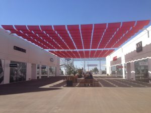 Red commercial slide on wire awning