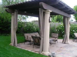 Custom awning with grey outdoor drapes