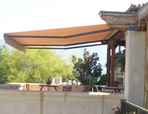 Orange awning fabric on a residential retractable awning