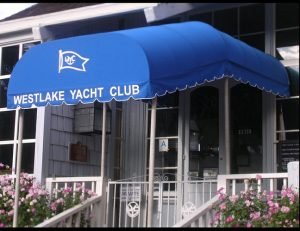 Blue awning fabric on an entrance awning for Westlake Yacht Club