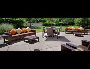 Brown pad cushion with custom fabric for patio furniture