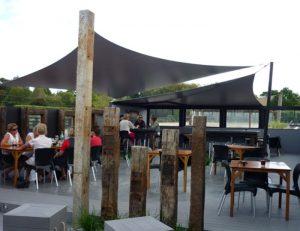 Grey sun shade panels for an outdoor area