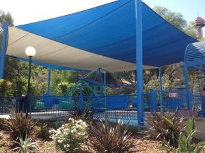 Custom blue and grey fabric cover at an amusement park