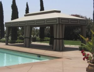 Custom cabana with olive awning fabric next to a pool