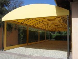 Carport awning with light yellow awning fabric