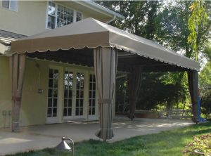 Outdoor patio shade awning with olive awning fabric