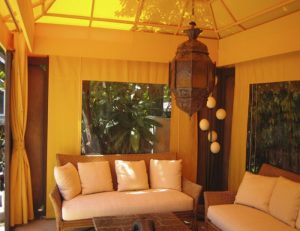 Custom cabana with yellow awning fabric and custom drapes