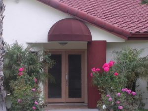 Residential dome awning with red awning fabric