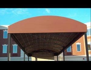 Metal walkway awning with brown awning fabric