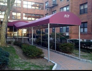 Metal entrance awning with white awning graphics