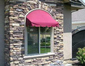 Residential window awning with red awning fabric