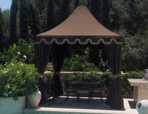 Pool cabana with brown awning fabric