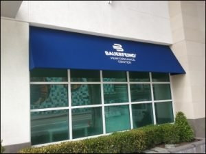 Blue storefront awning for Bauerfeind Performance Center
