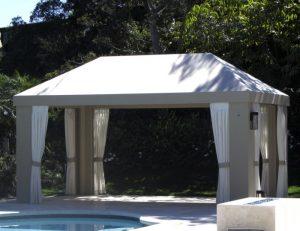 Custom cabana with grey awning fabric and white drapes