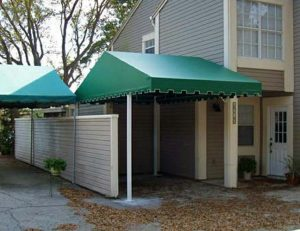 Residential carport awning with green awning fabric