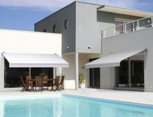 Grey retractable awning design for a home
