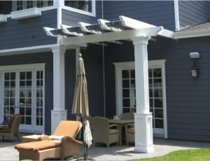 Custom residential trellis cover with white and dark blue accents