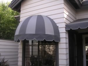 Residential dome awning with light and dark grey awning fabric