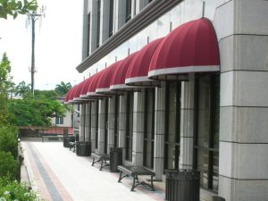 Commercial dome awnings with red and white awning fabric