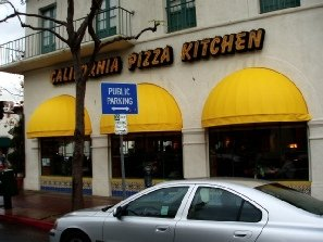 Yellow awning covers and window shades for California Pizza Kitchen