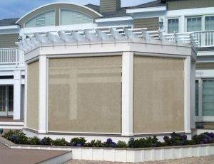 Tan drop-roll awning covers