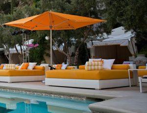 Custom orange patio cushions and orange commercial shade umbrellas