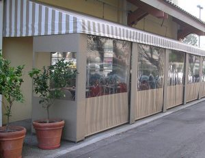Commercial drop-roll awning cover for a patio area