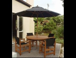 Black residential umbrellas and patio cushions