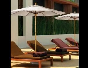 White commercial umbrellas for pool areas