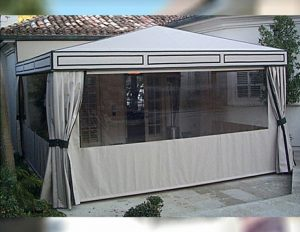 Patio shade awning with white awning fabric and clear plastic panels