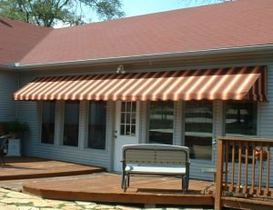 Residential patio awning with striped awning fabric