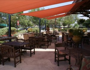Commercial tension sun shades with red awning fabric