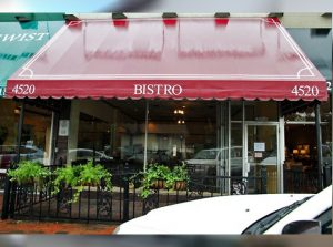 Red storefront awning and patio awning for a bistro