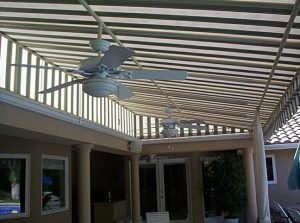 Custom patio shade awning with white and green striped awning fabric
