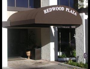 Black entrance awning for Redwood Plaza