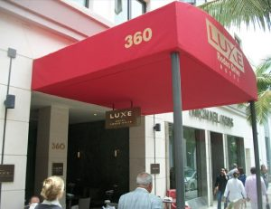 Entrance awning with red awning fabric for the Luxe Hotel
