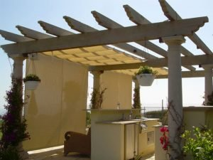 Trellis cover with white slide wire awning