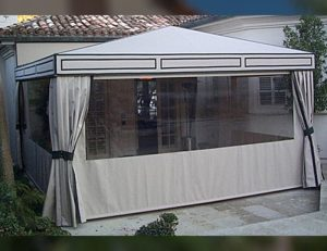 White awning fabric on a residential drop-roll awning