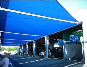Commercial sun shade panel with blue awning fabric