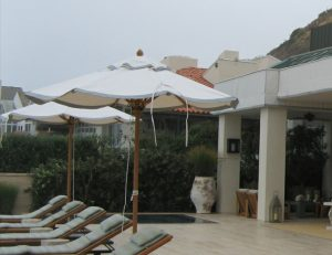 White commercial shade umbrellas with grey accents