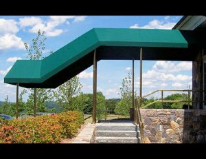 Commercial entrance awning with green awning fabric
