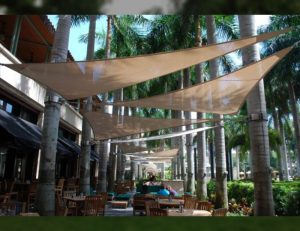 Commercial sun shade sail with light brown awning fabric