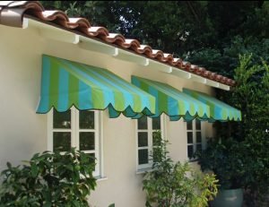 Blue and green residential window awnings