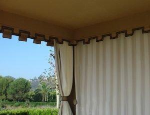 Cabana with custom striped drapes