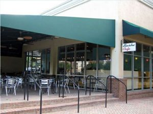 Green storefront awning and green patio awning